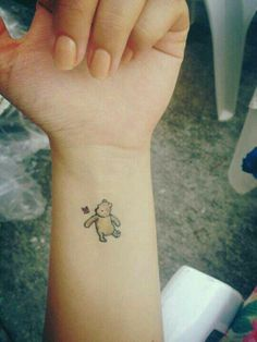 cute simple Winnie the Pooh tattoo