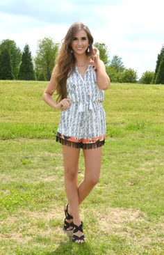 How cute is this romper?? With its tribal print and its fun fringe, you're sure to make a fashion statement!