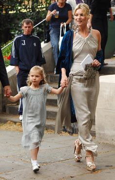 Kate Moss (in Chanel dress) and Lila Grace