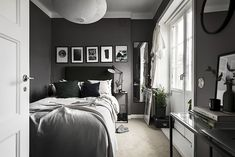 A Small Apartment Decorated In Dark Colors - Gravity Home