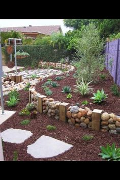 I love the rock wall idea. This would easily wrap around a rounded patio area, then just add wood on top for beautiful and unique seating!