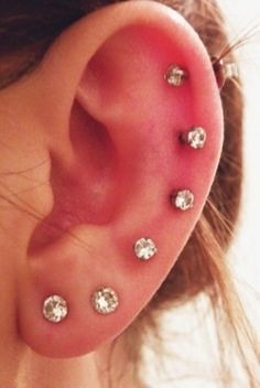 I've got several piercings in both ears. Not as many as this woman has in the photo but currently 3 piercings in each ear. Piercing Tattoo, Body Piercings, Cartilage Piercings, Full Ear Piercings, Piercing Chart, Lobe Piercing, Beads Jewelry, Jewlery, Copper Jewelry