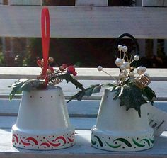"""Flower pot bell ornament. Simple and easy! Paint the pot, add a holly sprig decoration by poking it through the drainage hole and gluing in place, finish it off with a jingle bell attached to a ribbon pulled through from the inside for hanging. Use a 2"""" flower pot. Decorate the rim of the flower pot with checks, polka dots, sponging, whatever you prefer."""