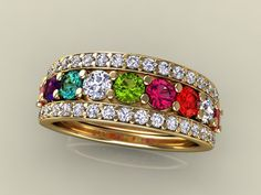 My dream family ring.  With my family stones it'll run around 2K$  I so love it! <3