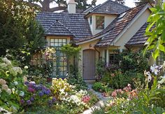 Cottage Exterior of Home with Kaiser Wood Shake Roofing, French doors, Transom…