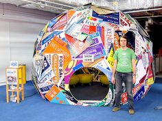 This was its public debut at Maker Faire UK, part of Newcastle Science Fest 2011.  The dome is 4 metres in diameter, 3 metres high, constructed from 135 estate agent boards and 25 wooden poles. The outer shell is held together with 270 plastic nuts and bolts.