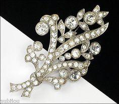 "Description: Vintage signed Bogoff floral motif brooch, rhodium plated, clear rhinestones. Designer/Makers Marks, Hallmarks, Tags: Bogoff Age: Circa 1950's. Dimensions: 2.9""x1.6"" Condition: Excellent"
