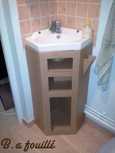 Upcycled Cardboard around a Siphon as Bathroom Furniture Recyclart Diy Furniture Nightstand, Diy Cardboard Furniture, Cardboard Storage, Cardboard Crafts, Recycled Furniture, Bathroom Furniture, Cardboard Playhouse, Art Furniture, Furniture Design