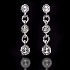 Gorgeous wedding earrings with round rhinestones and jewel adorned links. They are about 2.75 inches long and 3/8of an inch wide.