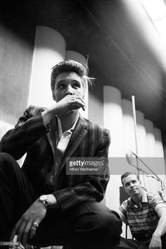 Alfred Wertheimer/Getty Images) Low-angle view of American musician (and actor) Elvis Presley (1935 - 1977) between takes during a recording session in RCA Victor's Studio 1 (on East 24th Street), New York, New York, July 2, 1956. At the session, he and his band recorded both 'Hound Dog' and 'Don't Be Cruel.'