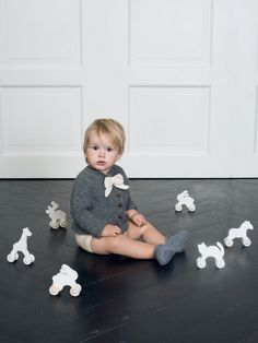 Hand knitted Lukas cardigan, Kai soakers and Clara bootees with natural coloured wooden toys