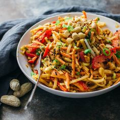 This Thai-inspired recipe consists of noodles, healthy vegetables, a tasty and spicy peanut dressing, and is topped with sesame seeds.