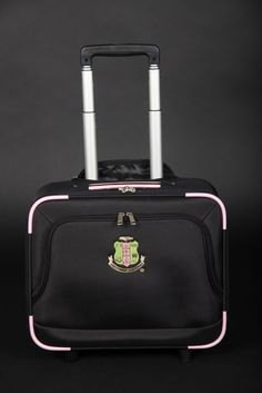 Make a statement in the airport when you roll through with the 20 Pearls Rolling Laptop Briefcase.    Black rolling briefcase trimed in Pink and includes the sorority crest embroidered. #AKA #AKA1908 #AKA20Pearls