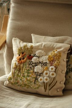 crewel embroidery pillow, via Flickr.