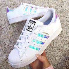 Sz7.5 Superstar Adidas Original White Metallic Low cut iridescent rainbow stripe white New sneakers in original box! I got them and they are not my color . Big kids 6.5/ mens 5.5/ women's 6.5. These run big and fit me 7.5 perfect! I tried them on with socks once, and out right back into box. Adidas Shoes Sneakers