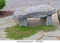 Small natural stone garden bench
