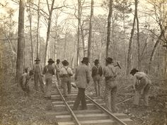 Steel Gang Laying a Logging Railroad in the Piney Woods of East Texas (From the East Texas Research Center Collection).
