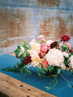 Lush floral design transformed an industrial wedding venue into a garden-style oasis filled with whimsy and elegance.