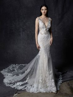 The epitome of glamour. This curve hugging full length mermaid gown comes with Enzoani's signature train. Delicate beading lines its low plunging neckline along with its low v back, all over chantlily lace completes this impressive luxe gown. Wedding Dress Pictures, Sexy Wedding Dresses, Elegant Wedding Dress, Designer Wedding Dresses, Bridal Dresses, Wedding Gowns, Bridesmaid Dresses, Dress Out, Mermaid Gown