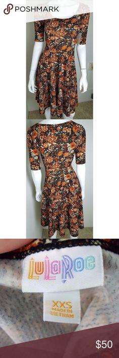 Lularoe Black Dress Orange Flowers XXS Black dress with orange flowers. Textured material. Brand new with tags. No flaws. Women's size XXS.  95% Polyester 5% Spandex  #1805 LuLaRoe Dresses Midi