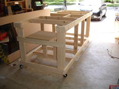 Backyard Workshop - Ultimate Workbench Photo sequence for building a workbench with built-in table saw and router.