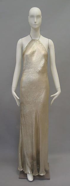 1936 Madeleine Vionnet dress shows the neckline that became popular in the 30s. It could be seen on anything from swimsuits to evening dresses. Helped elongate the the women's body