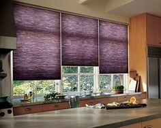 Energy efficient rich hues brings a sleek feel into this kitchen––Duette® Honeycomb Shades ♦ Hunter Douglas Window Treatments