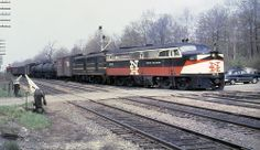 New Haven Railroad DER-3a ALCO PA-1 # 0775 & DER-1b ALCO DL-109 # 0722, are seen leading a mainline manifest freight train while it changes tracks at unknown grade crossing location, mid 1950's, Mac Seabree Collection