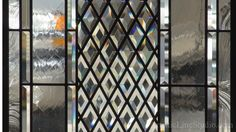 Leaded glass window with beveled cluster and clear beveled diamonds