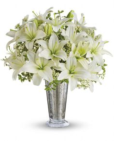 Echoing a romantic night sky, this classic arrangement of silver and white is perfect for a silver anniversary or any special star in your life. Fragrant snow-white lilies and a stunning mercury glass-style keepsake vase invite your lucky someone to wish upon a star!