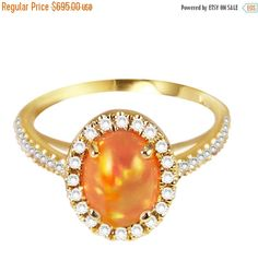 CHRISTMAS SALE Mexican Fire Orange Opal with Yellow and Green Sparkles, 14kt Yellow Gold, Diamond Halo Ring handmade by Gevani Jewelry by GevaniJewelry on Etsy https://www.etsy.com/listing/256485609/christmas-sale-mexican-fire-orange-opal