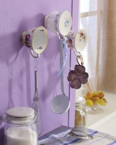 vintage cups used for utensil hangers ~ nice if you have wall space.