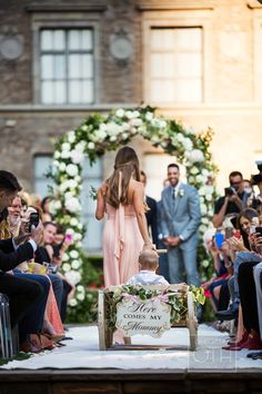 "Ring Bearer in Wagon with ""Here Comes My Mommy"" Sign 