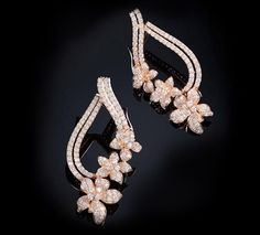 Rose Gold Diamond Earrings Diamond earrings set in 18K Rose gold.