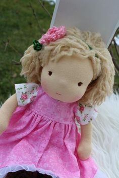 This is Gabi. She is about 12 inch tall. (30 cm) Her skin is 100% cotton interlock. Her body is stuffed with pure wool from sheep. Its included outfit and accessories. All Mary Dolls are soft, comfortable to the touch and stuffed firmly with 100% organic washed and carded wool. Its