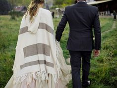 Mix in casual, ready-t0-wear pieces with your formal gown to stay warm on chilly nights. This wool poncho is the perfect way to cozy up at your ranch wedding and up your fashion cred.