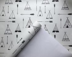 Pattern Name: Random Teepee - Black & White Pattern Repeat: 437mm wide x 362mm high Bespoke self adhesive, removable and reposition-able fabric wallpaper. Get the look and feel of a traditional wallpaper without the fuss! No water, paste, or tradesman required. We recommend that