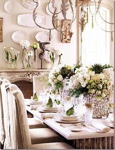 rustic european style dining table. linen slipcovers on dining chairs