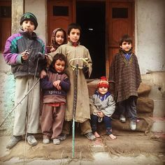 Sajad and gang posing for the photograph with their bent wire steering wheel. Location: Naranag, small village in kashmir #naranag #kids #toys #srinagar #kashmir #india #travel #solotravel #trodly #getoutside #makememories