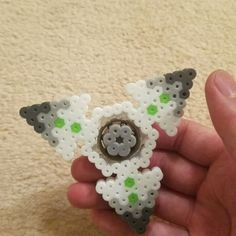 Genji Shuriken fidget spinner! Don't think I've ever seen one made with beads. I'd like to think I'm the first :P Recently I've been really into fidget spinners but I didnt want to buy one online. Figured I could try to make my own and make whatever designs I could come up with. I'm addicted now. Original design. Please credit if you use this. Thank you! #artkal #artkalbeads #perler #perler #perlers #perlerbead #perlerbeads #perlerart #bead #beads #beadart #pixelart #fidget #fidgetspinner...