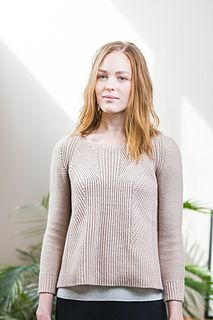 This architectural A-line pullover in Arbor surprises the eye with unexpected intersections of ribbed texture. Columns of half-twisted single rib climb the body from the split hem and then begin to diverge and overlap in geometric panels. Arbor's round, 3-ply construction and worsted spin renders every line in the crispest definition. Bracelet-length sleeves in reverse stockinette and an open neckline balance the wide hem and the busy fabric of the torso.