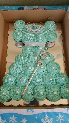 Disney Frozen theme for my daughter's 4th birthday party.  Cupcakes shaped like a princess dress with a crown, pearls, and a wand. #princesscake #cupcakes