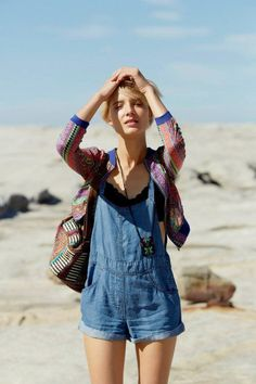 For a really casual look, wear your overalls over a bandeau, and add a kimono jacket or cardigan over the whole outfit.