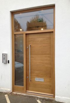 contemporary oak door with toplight and sidelight