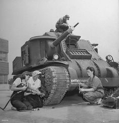 Women mechanics working on M3 tank at Alberdeen Proving Ground.