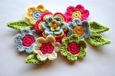 Pretty crocheted flowers by etsy seller AnnieDesign.