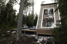 The house sits on the lakeside in the Finish wilderness, with views of the surrounding landscape...