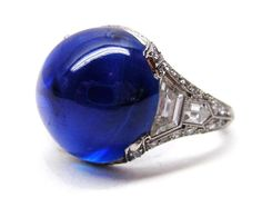 Sapphire cabochon and diamond ring by Udall & Ballou, American, c.1910