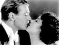 Gary Cooper experiences a moment of barely suppressed passion with Fay Wray.  C1925