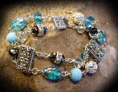 Ocean blue glass beads with Silver colored by KimsKreationsNC, $15.00